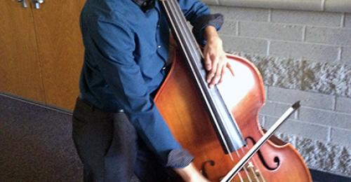 Maryvale High School student Hector Villalba plays the cello.